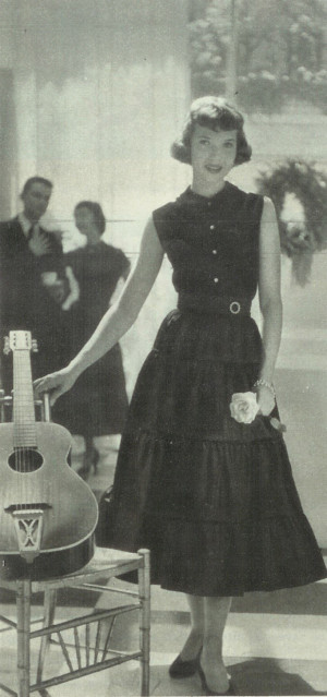In this photo from a fashion feature, the guitar is a prop.  Girls were rarely shown playing, or even touching, guitars in Seventeen in the 1940s and '50s (Seventeen Dec 1949)